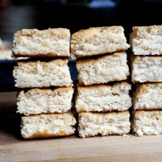 Triple Coconut Bars made from Coconut Oil, Coconut Extract and Coconut Flour. Chewy, rich and intensely coconutty (and they just happen to be gluten-free). I lifeaswecookit.com