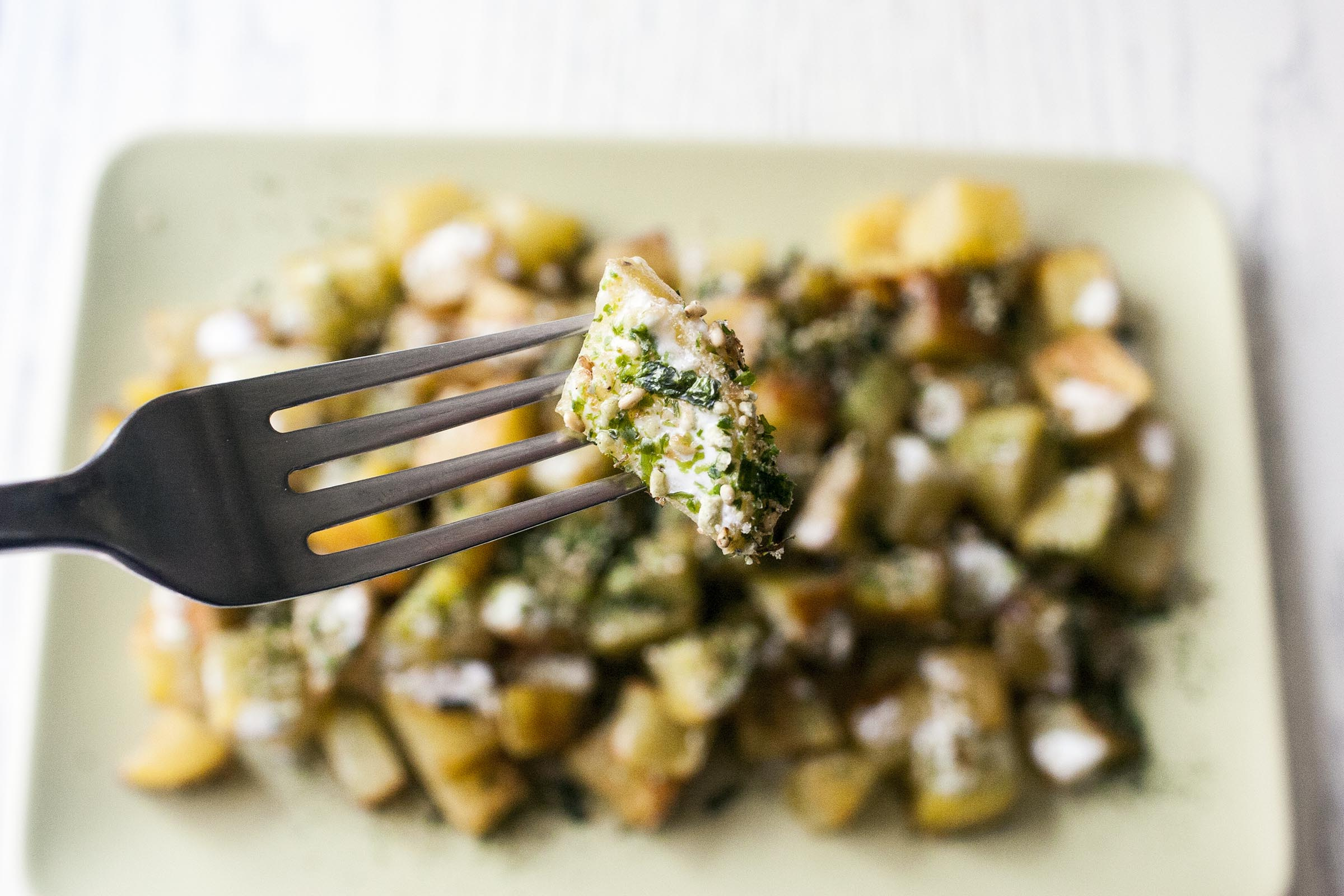 Roasted Furikake Roasted Potatoes on a fork. lifeaswecookit.com