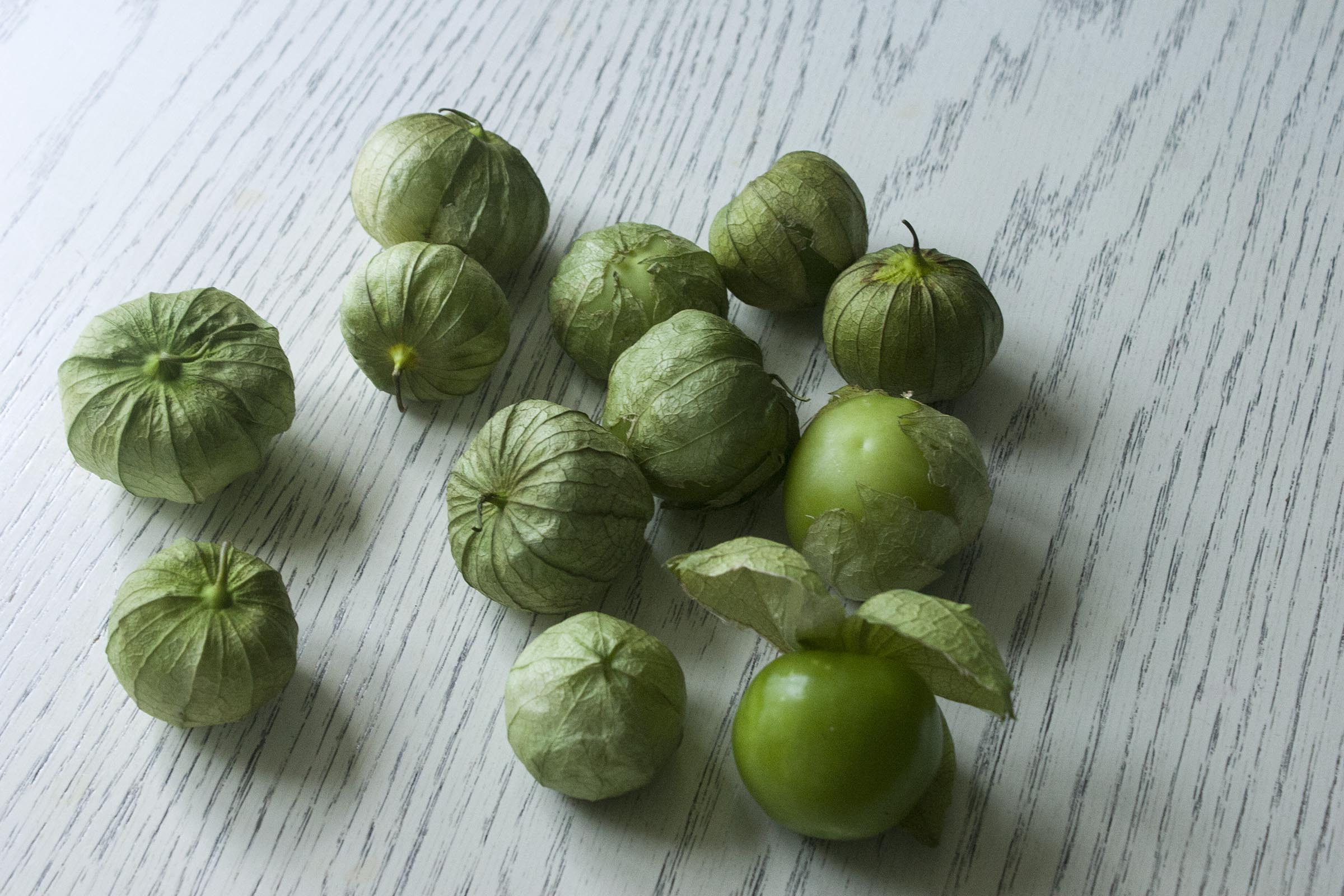 Tomatillos not yet husked for Fresh Tomatillo & Avocado Salsa. www.lifeaswecookit.com