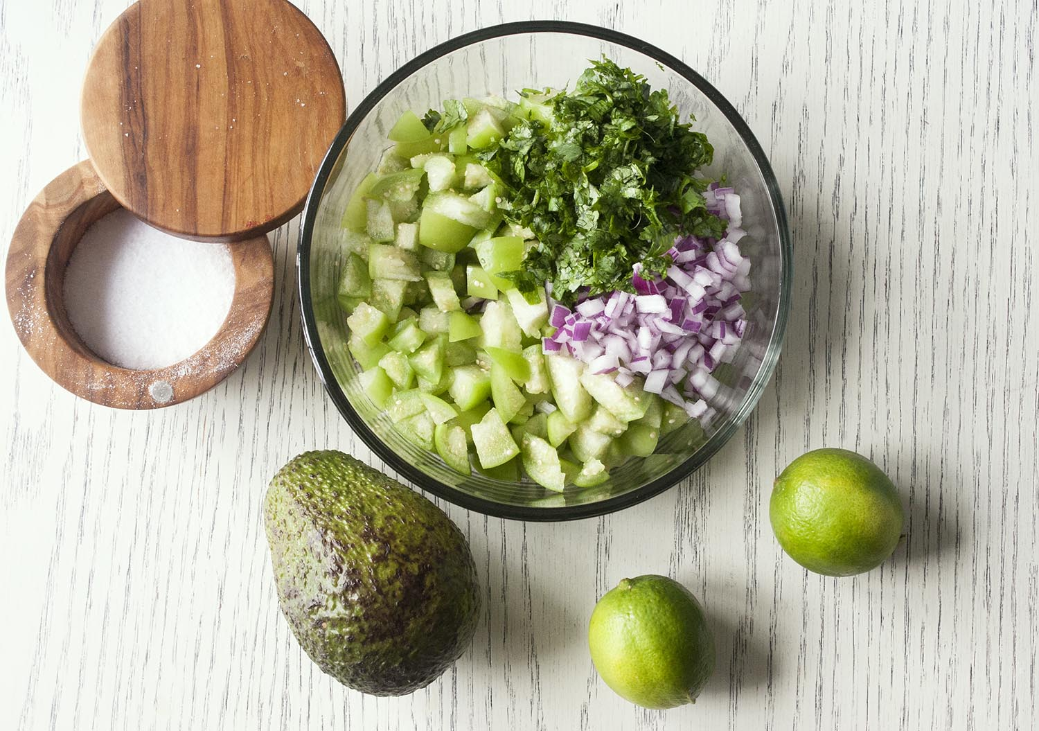 Ingredients for a fresh, chunky and bright Tomatillo & Avocado Salsa. www.lifeaswecookit.com