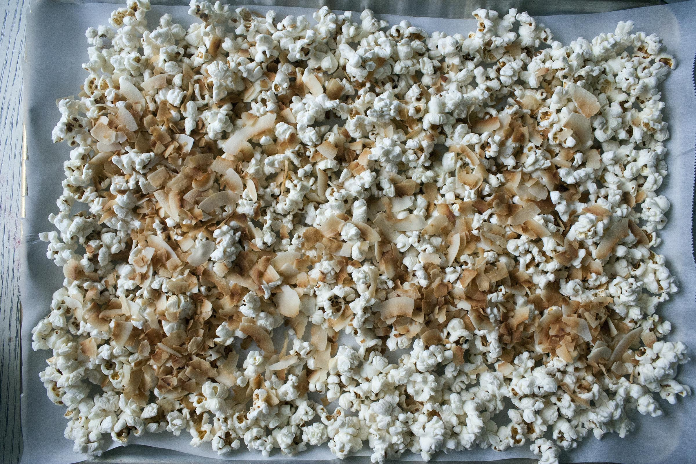 Popped Popcorn, Kosher Salt and Toasted Coconut Flakes for Coconut and Raspberry-Drizzled White Chocolate Popcorn www.lifeaswecookit.com