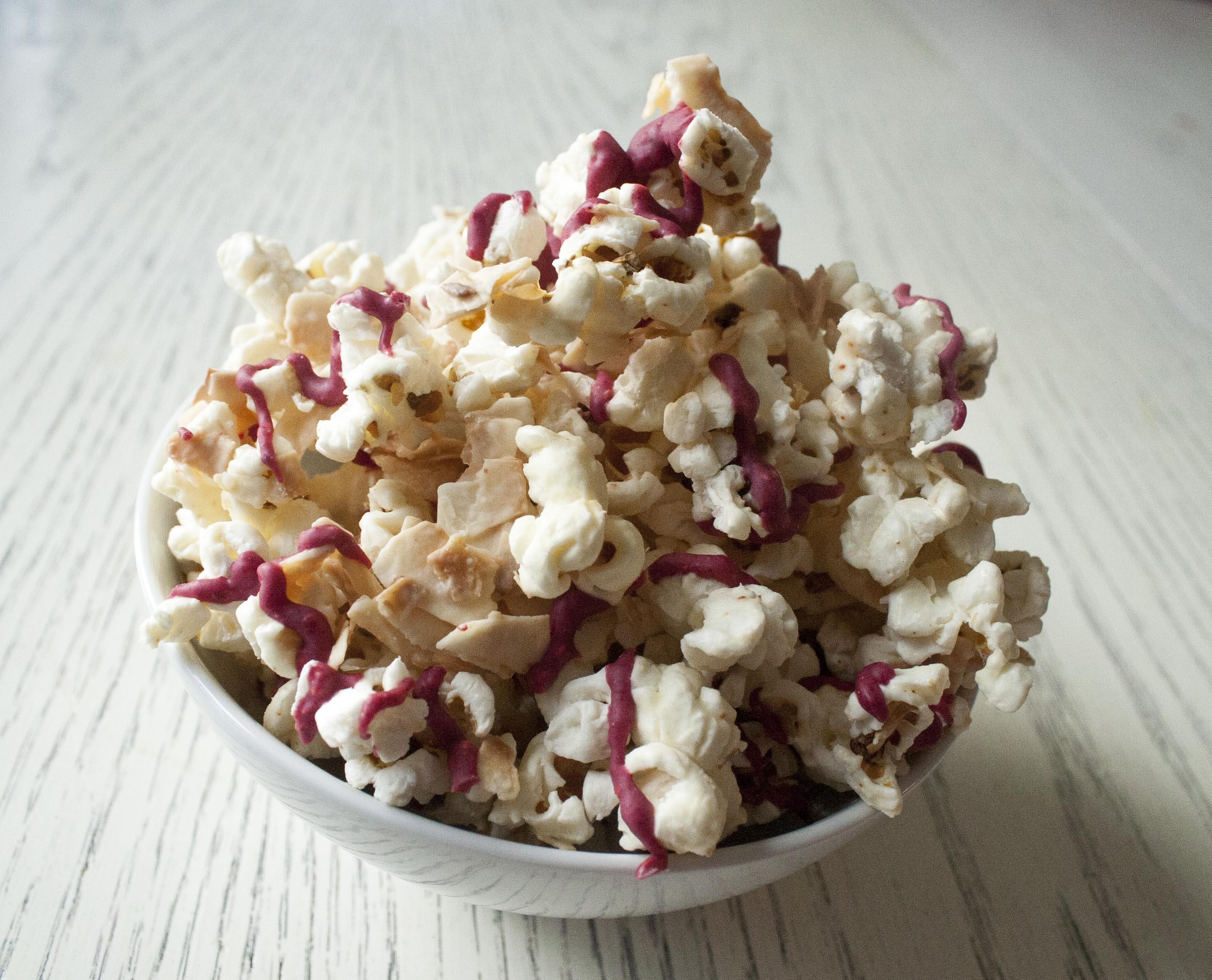 Coconut and Raspberry-Drizzled White Chocolate Popcorn www.lifeaswecookit.com